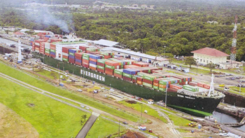 Container ship transiting Gatun Locks, the only set of locks of the Panama Canal on the Atlantic side of the isthmus of Panama.  [Courtesy of  Panama Canal Authority from its El Foro newsletter, 17-30 October 2003]